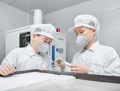 Workers in cleanroom